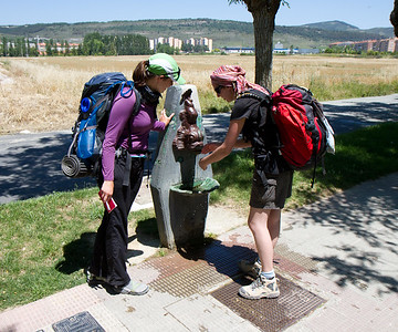 Pilgrims on the Camino de Santiago refresh their water supply on the way into Pamplona.