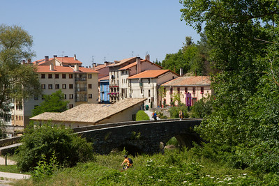 Entering the town of Villava, a suburb of Pamplona, over a medieval bridge on the Camino de Santiago.