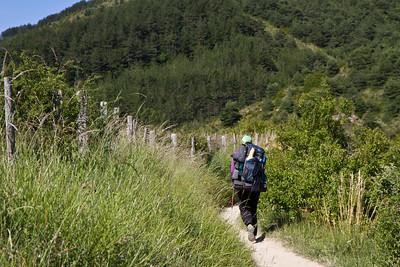 Anna Dintaman, author of Hiking the Camino, walks along a dirt path after Larrasoaña on the Camino de Santiago.