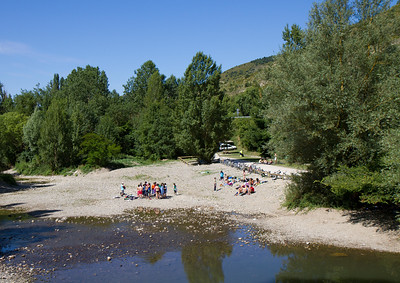 A riverside beach attracts beach-goers on the Arga River near Pamplona, Spain on the Camino de Santiago.