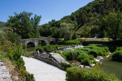 Entering the town of Villava, a suburb of Pamplona, over a medieval bridge on the Camino de Santiago.
