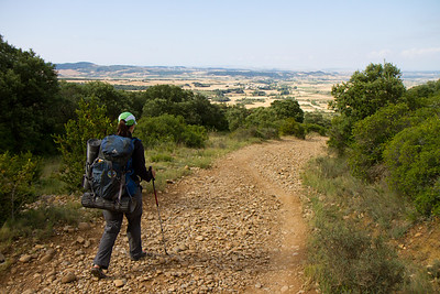 Author Anna Dintaman treks down from Alto de Perdón toward the town of Uterga.