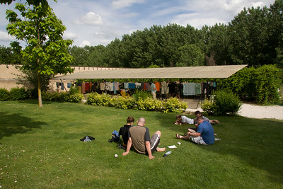 Pilgrims relax and hand laundry behind the albergue Padres Reparadores in Puente la Reina on the Camino de Santiago.