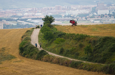 Pilgrims walk the plains between Cizur Menor and Alto de Perdon on the Camino de Santiago.