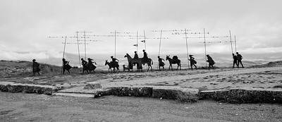 "A statue of medieval pilgrims stands at Alto de Perdón, the former site of a pilgrim church and hospice.  An inscription reads, ""Donde se cruza el Camino del viento con el de las estrellas.""  Where the way of the wind meets that of the stars."