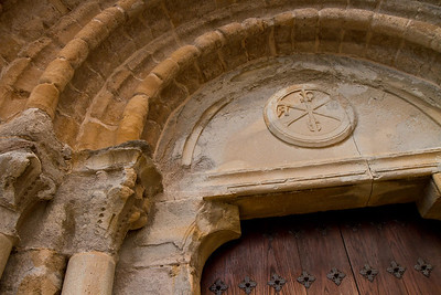 The entrance door to the Church of San Miguel bears the ancient Christian symbol of the chi rho.