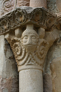 A carved capital at the Church of Saint Mary of Eunate can be viewed as a man with a curly beard, or an upside-down ram.