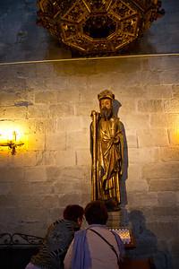A golden statue of Saint James the pilgrim decorates the Church of Santiago in Puente la Reina on the Camino de Santiago.