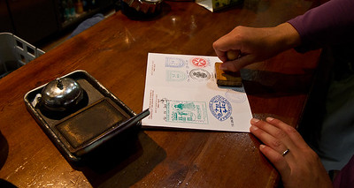 A daily pilgrim ritual-- collecting stamps in the credencial (pilgrim passport) from accommodations and other sites along the Camino de Santiago.