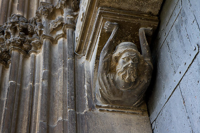 A carving of a bearded Jew holds up the tympanum at the Church of Santo Sepulcro in Estella, symbolizing the Jewish foundations of the Christian faith