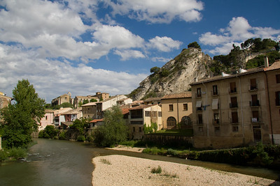 Houses line the banks of the Ega River in Estella, Spain.