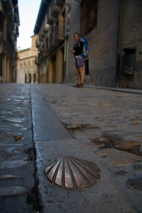 Metal shells imbedded in the sidewalk mark the path of the Camino de Santiago through Estella.
