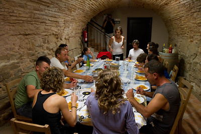 Pilgrims at La Casa de la Abuela albergue in Los Arcos enjoy a spaghetti dinner together.
