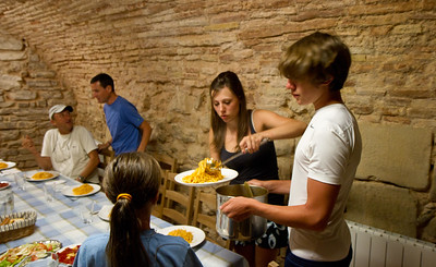Italian pilgrims prepare a spaghetti meal for all the guests in La Casa de la Abuela albergue.