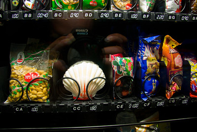 Vending machines offer more than snacks; this one includes a traditional pilgrim shell!