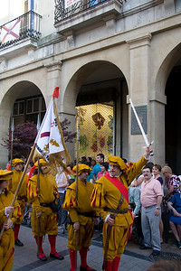 A festival in Viana, Spain, includes a parade through the main plaza.