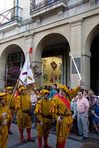 A festival in Viana, Spain, includes a parade through the main plaza.