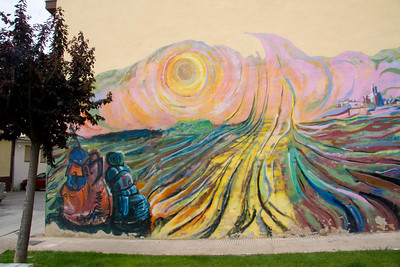 A mural of fields with backpacks entering Viana recalls the pilgrim experience.