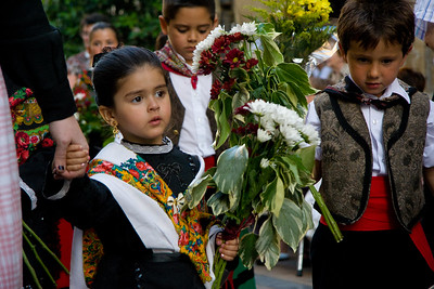 A festival in Viana, Spain, includes a parade through the main plaza.  This Spanish girl is dressed in traditional costume.