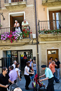 Spaniards in Viana stroll the streets during a festival.