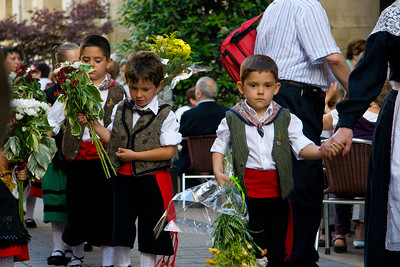 A festival in Viana, Spain, includes a parade through the main plaza.  These Spanish boys are dressed in traditional costume.