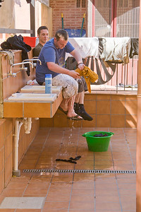 A weary pilgrim does his laundry in the albergue of Santo Domingo de la Calzada.