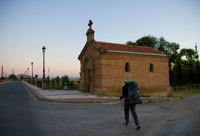 "Leaving Santo Domingo de la Calzada, pilgrims pass the Ermita de la Puente (""Hermitage of the Bridge"") before crossing the Río Oja."