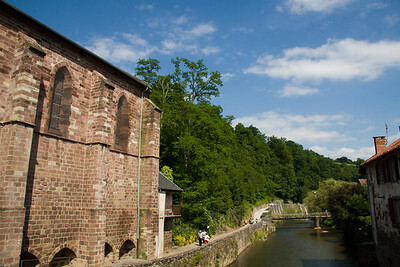 Pilgrims walk along the River Nive in the medieval town of St-Jean-Pied-de-Port, France, the traditional starting point for the Camino de Santiago.