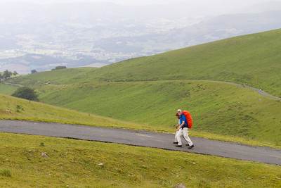 Pilgrims endure grey weather as they cross the Pyrenees on the first day of the Camino de Santiago.