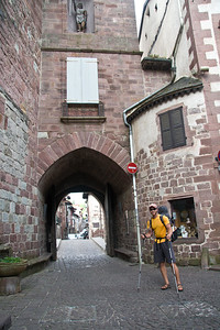 Pilgrims walk through the Porte d'Espagne (the door to Spain) as they exit St-Jean-Pied-de-Port to begin their journey over the Pyrenees to Santiago.