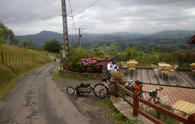 "A bicycling pilgrim or ""bicigrino"" stops for a water break on his journey over the Pyrenees on the Camino de Santiago."