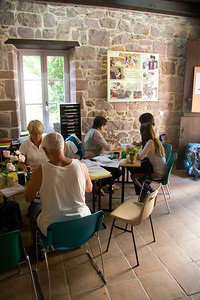 Inside the Pilgrim Office of St-Jean-Pied-de-Port, volunteers help pilgrims prepare for the journey.