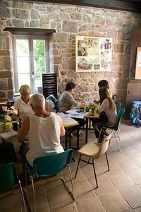 Inside the Pilgrim Office of St-Jean-Pied-de-Port, volunteers help pilgrims prepare for the journey.