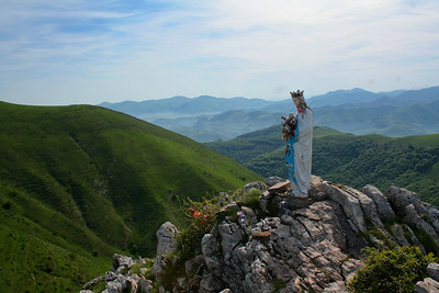 The Vierge d'Orisson (Virgin of Orisson) stands quiet vigil over the Pyrenees mountain range robed in pilgrim offerings.
