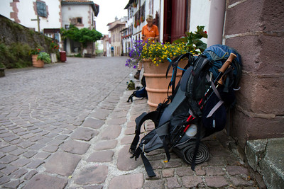 A pilgrim backpack at the municipal albergue of St-Jean-Pied-de-Port, France waits to begins its journey.