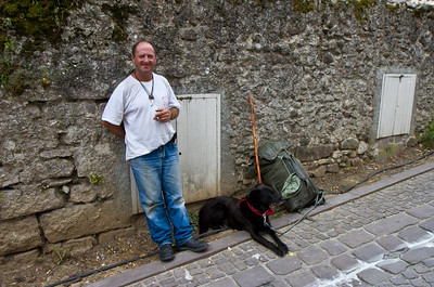 A pilgrim and his dog in St-Jean-Pied-de-Port, France.