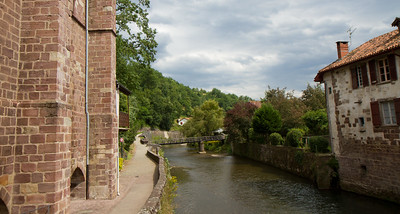 Crossing the River Nive in the medieval town of St-Jean-Pied-de-Port, France, the traditional starting point for the Camino de Santiago.