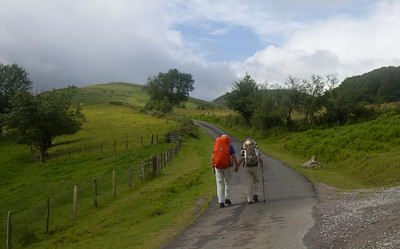 A pilgrim couple cross the Pyrenees hand in hand on the first day of the Camino de Santiago.