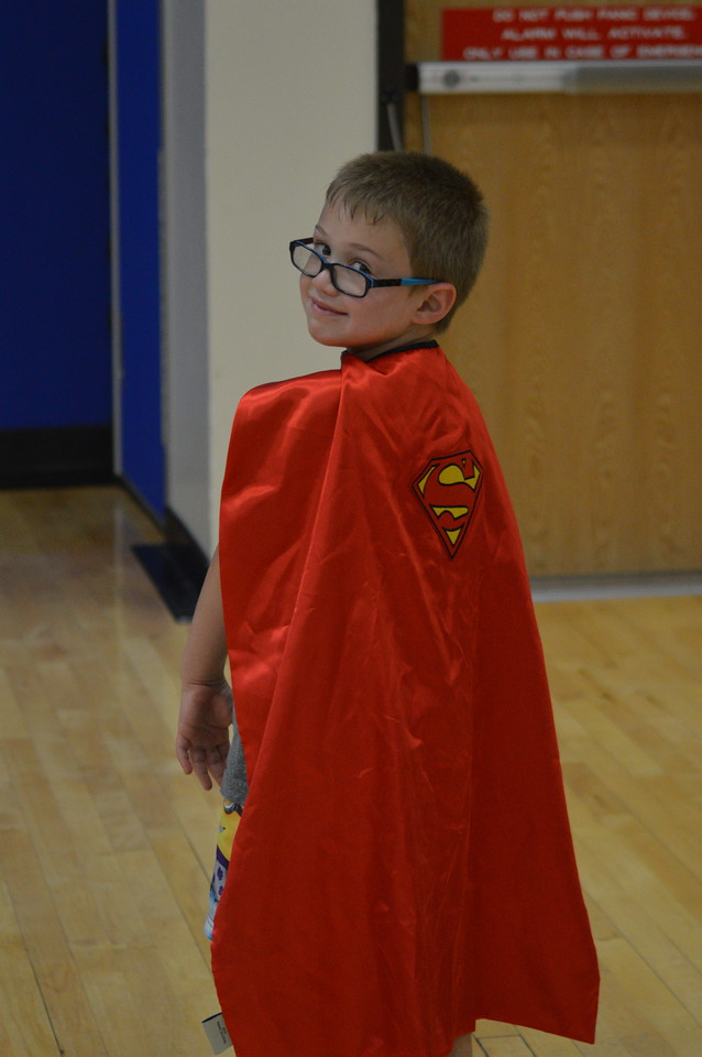 Boy posing as superman