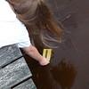 Testing water temperature.