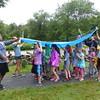 Rain inspires creative teamwork in the form of an umbrella-mobile