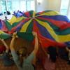Indoor parachute fun on a rainy day