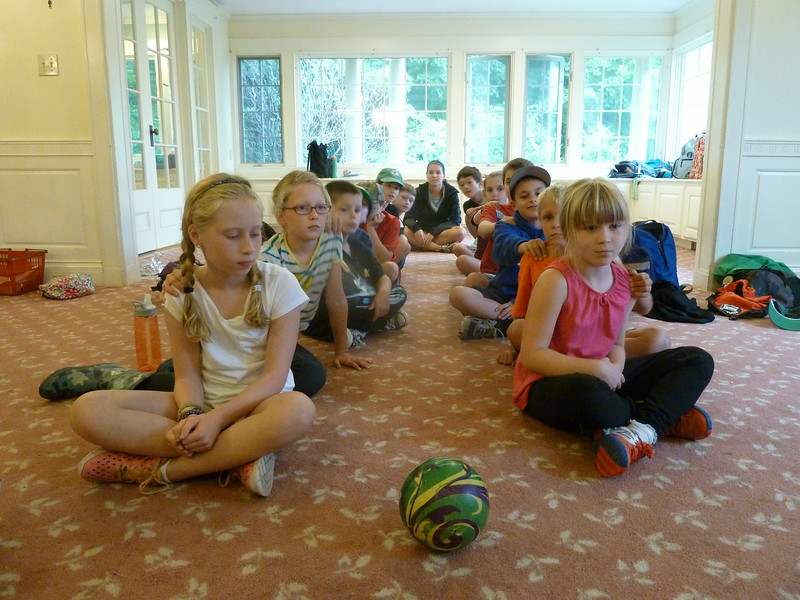 "Campers create their own storm with a game of ""Electricity""..."
