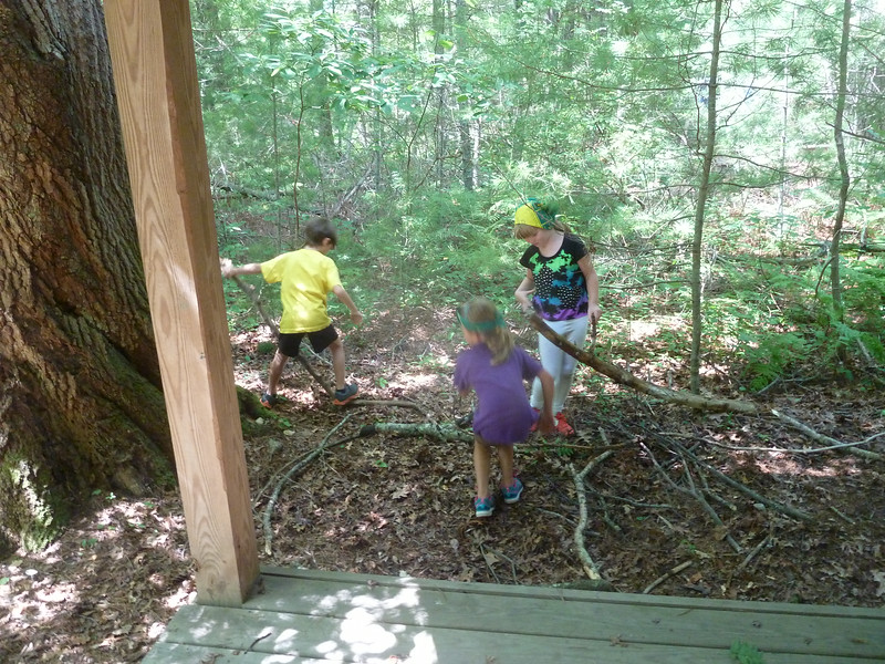 Campers build a nest for Counselors Turtle and Newt...