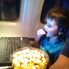 Grandpa and Nate flying Chicago to Rochester<br /> Having popcorn and watching a movie