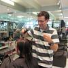 Eric is cutting Maria's hair