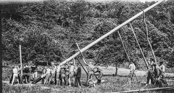 Raising first flagpole at Sequoyah