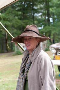 Woman trying on a felt hat...