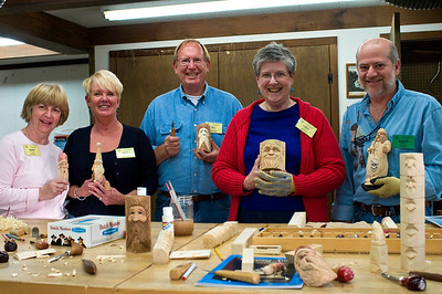 The woodcarving class, with Marvin their instructor on the right.