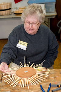 Georgeann finishes putting in staves on her first basket
